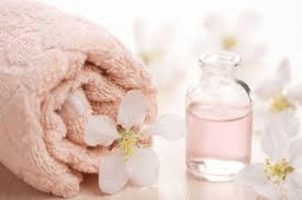 Lemon & Rosewater Foot Scrub with Epsom Salt & Coconut Oil     What you'll need:  ●	½ cup epsom salt ●	½ cup fresh lemon juice ●	2 tbsp rosewater ●	½ cup organic coconut oil ●	Mixing bowl and hand mixer (stand mixer will work, too)  Prep:  In a medium sized mixing bowl, combine ½ cup epsom salt, ½ cup fresh lemon juice, 2 tbsp rosewater,  and ½ cup coconut oil. Lightly mix the ingredients together using hand mixer until a fluffy paste is formed.   How to heal cracked heels with this foot scrub:  Massage your dry and cracked heels using your new foot scrub, using gentle, circular motions. You should be able to feel the grains of the epsom salt gently exfoliating your feet. The soothing rosewater and lemon helps replenish tired feet, while coconut oil, a natural antibacterial and antifungal, maximizes moisture restoration as well as helps fight off any possible bacterial or fungal infections that might be causing dry cracked heels.