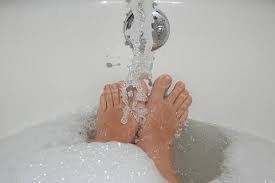 Letting feet sit in hot water is bad for good total foot care.