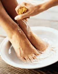 Wash feet thoroughly as good and healthy practice of good total foot care.